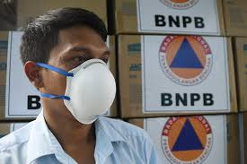 Male adult wearing disposable respirator mask