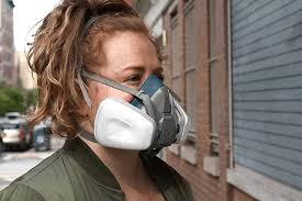 Female adult wearing respirator mask
