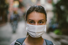 Female adult wearing surgical mask